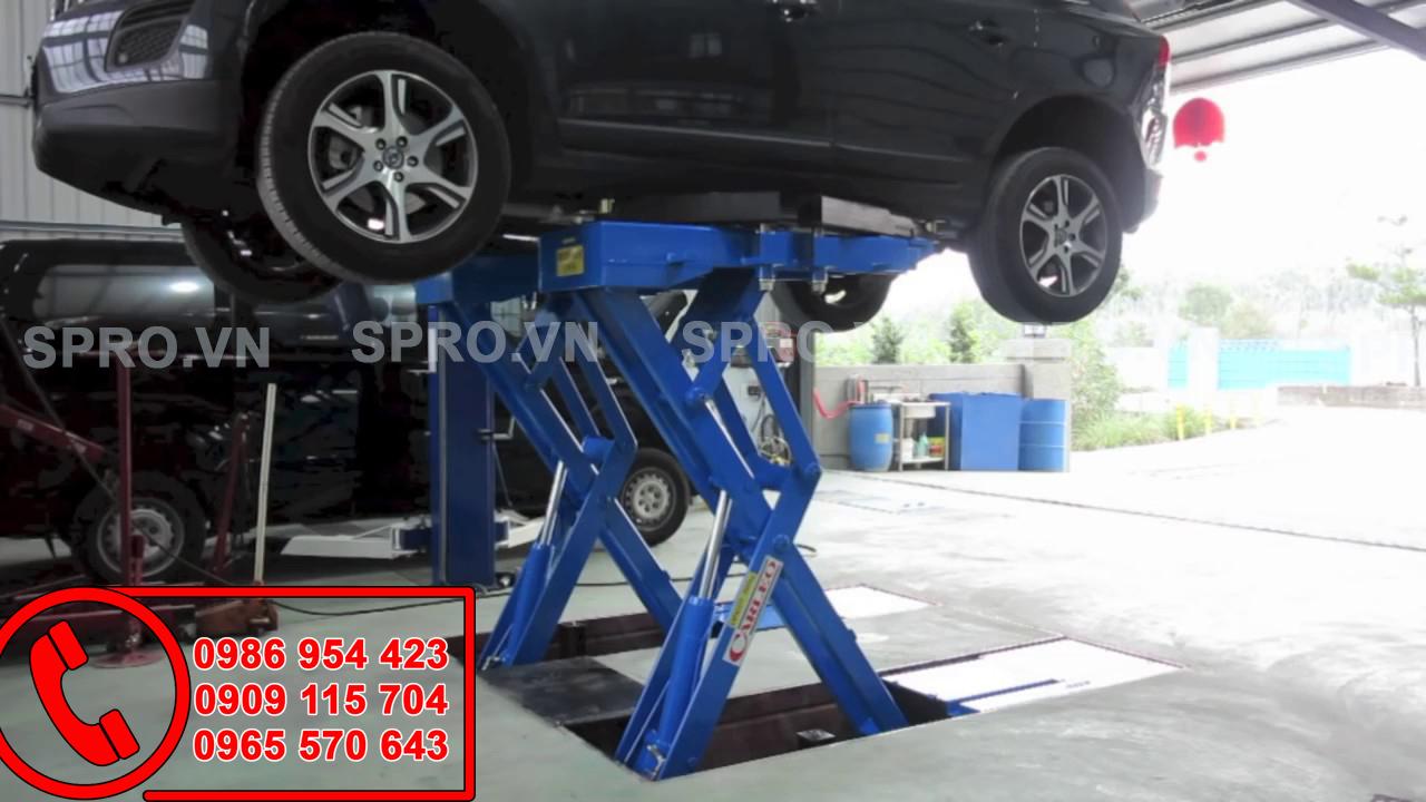 cầu nâng cắt kéo sử dụng trong gara ô tô